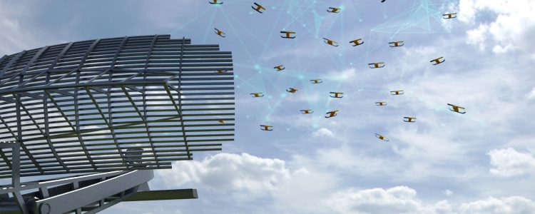 Image of drones swarming over a radar